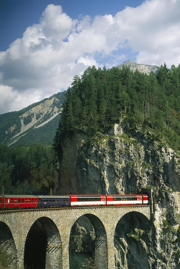A Train Passes Into A Photograph