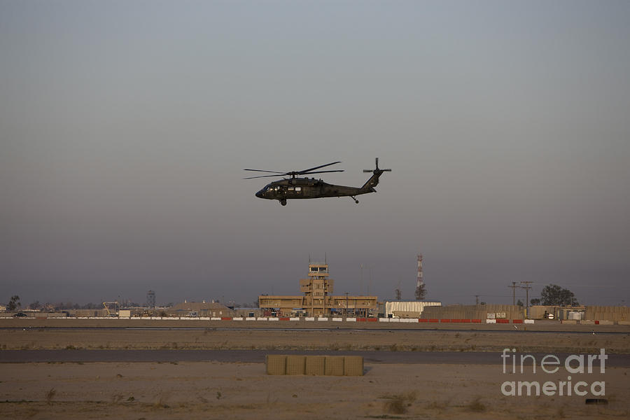 A Uh-60 Blackhawk Helicopter Flies Photograph