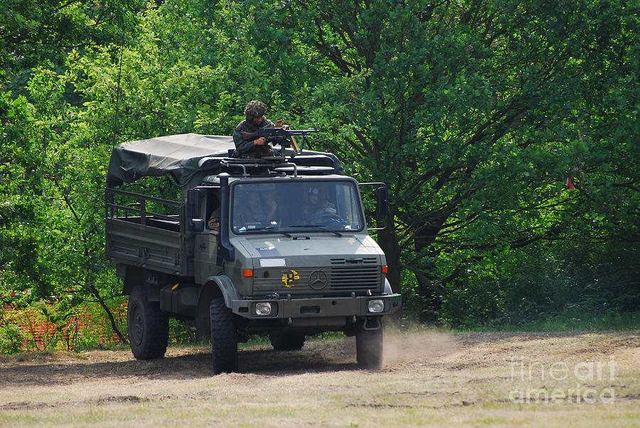 Unimog Photograph - A Unimog Vehicle Of The Belgian Army by Luc De Jaeger