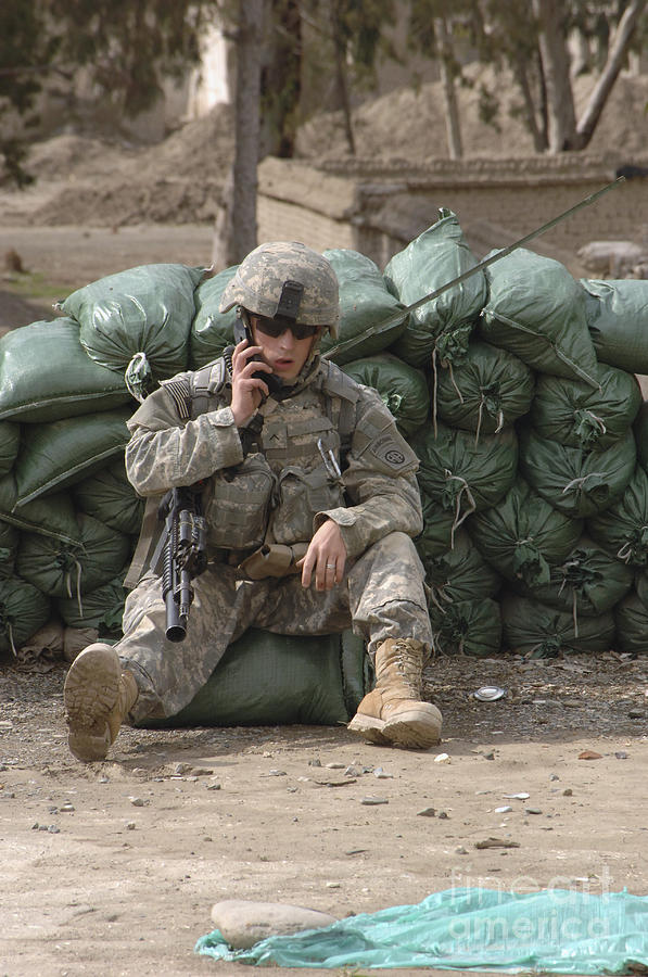 A U.s. Army Soldier Talks On A Radio Photograph