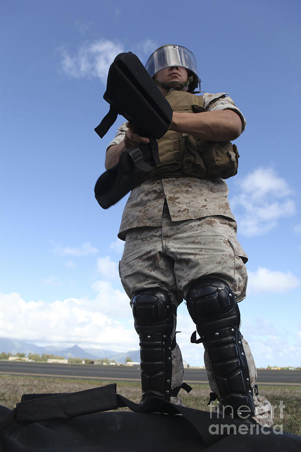 A U.s. Marine Dons Riot Gear For Drills Photograph