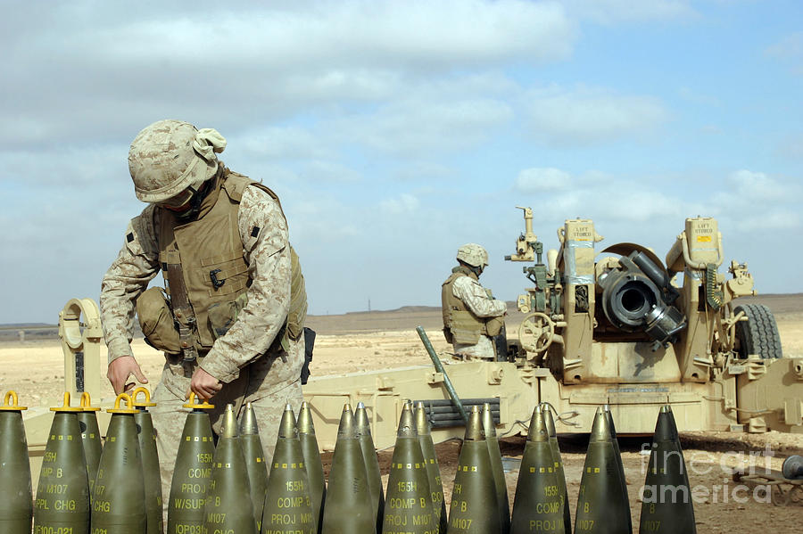 A U.s. Marine Prepares Howitzer Rounds Photograph