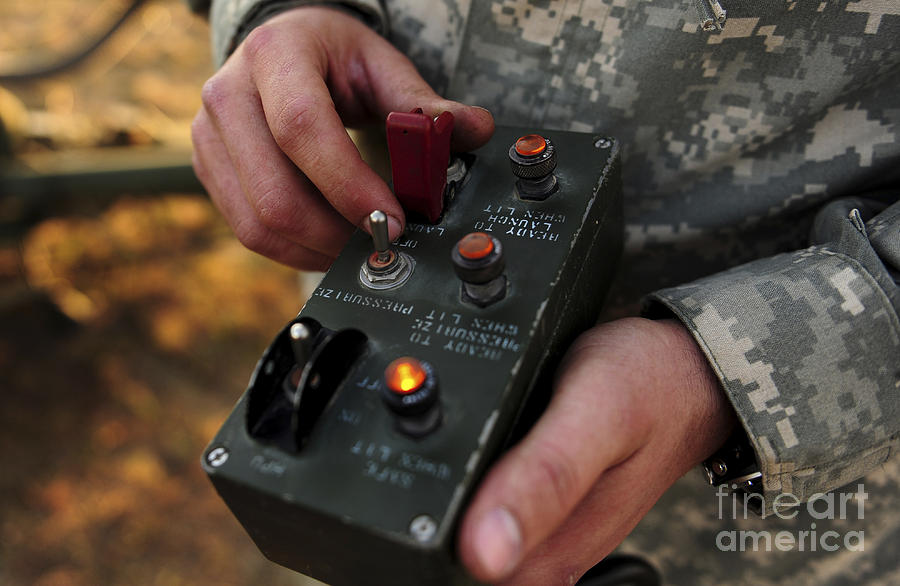 A U.s. Soldier Hits The Button Photograph