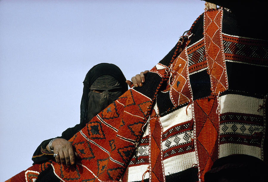 A Veiled Bedouin Woman Peers Photograph