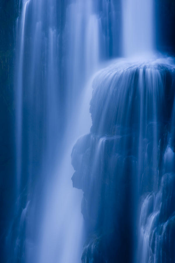 A Waterfall Splashes Off Of A Large Photograph