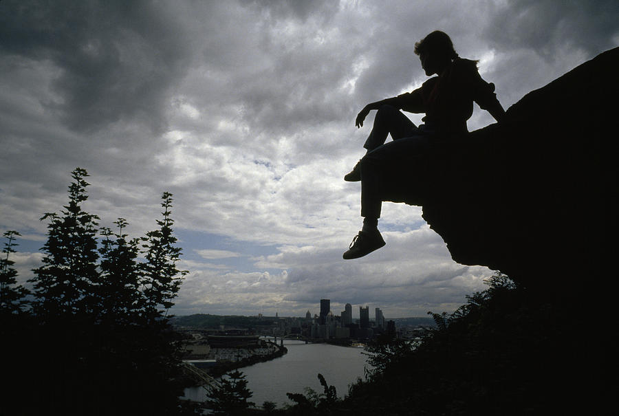 A Woman Perched On An Overlook Photograph