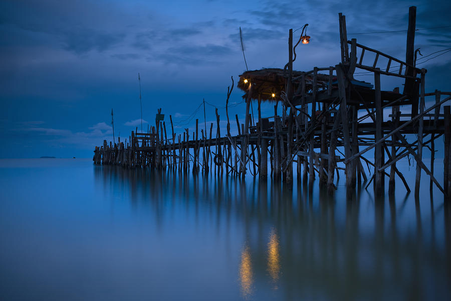 A Wooden Pier With Lights On It At Photograph  - A Wooden Pier With Lights On It At Fine Art Print