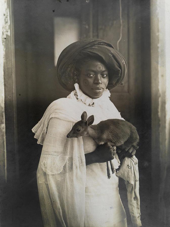 A Young Kenyan Woman Holds Her Pet Deer Photograph