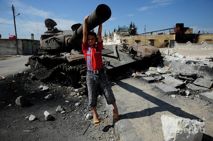 A Young Syrian Boy Plays On The Turret Photograph