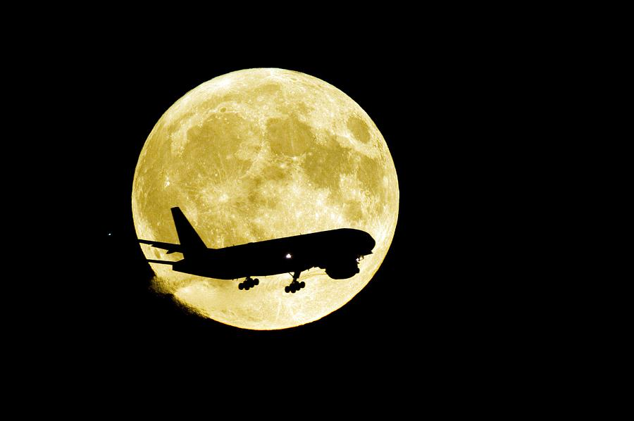 Aeroplane Silhouetted Against A Full Moon Photograph  - Aeroplane Silhouetted Against A Full Moon Fine Art Print