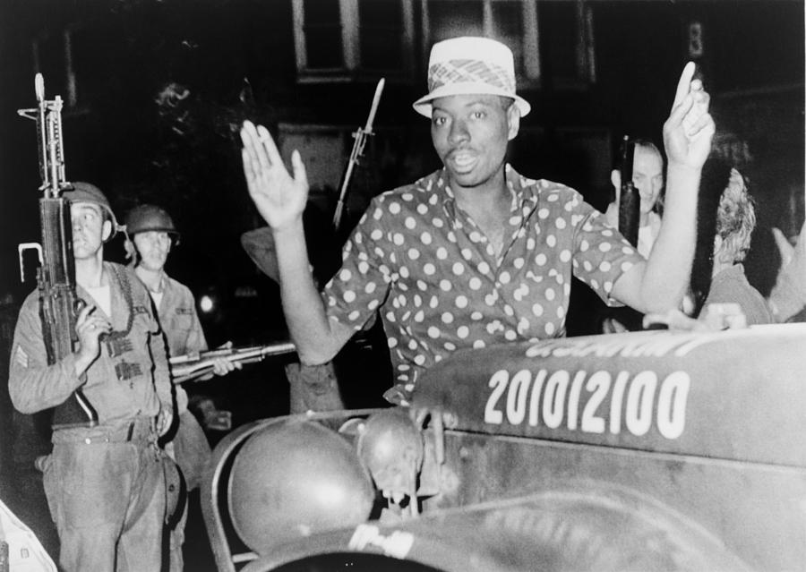 African American Man With Arms Raised Photograph