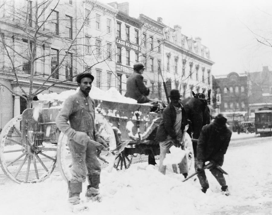African American Men Loading Snow Onto Photograph  - African American Men Loading Snow Onto Fine Art Print