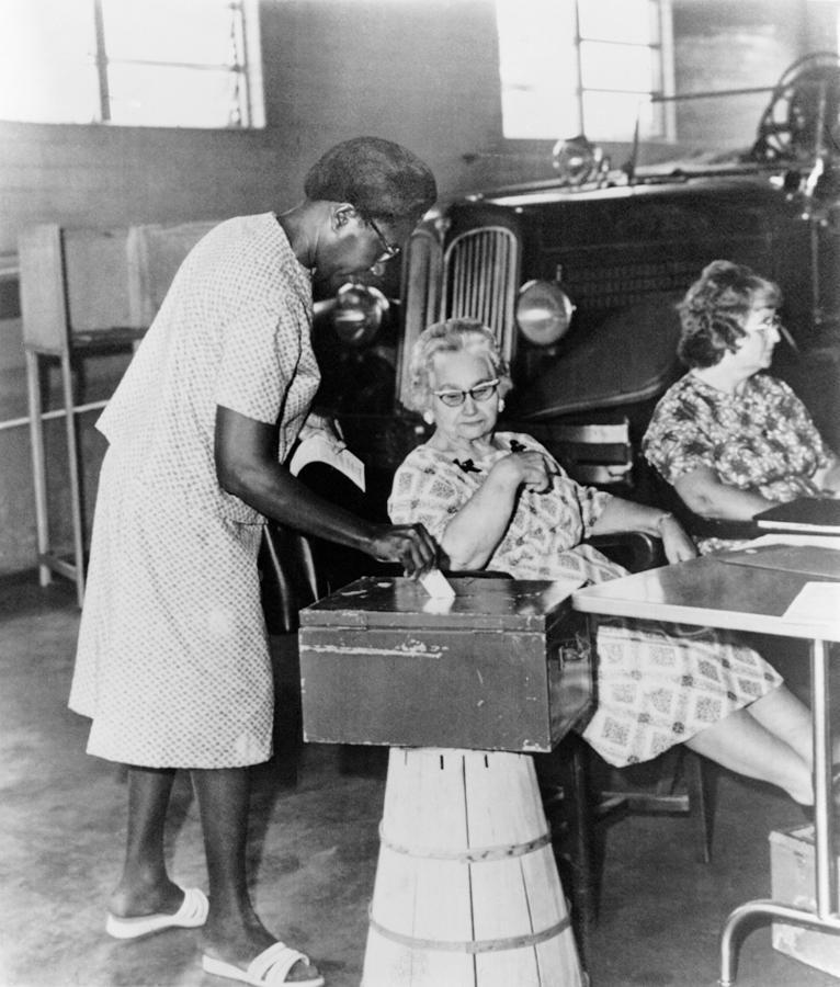 African-american Woman Placing Ballot Photograph