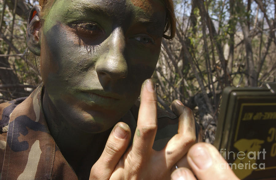 Airman Applies Camouflage Paint Photograph