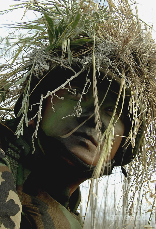 Airman Wearing A Ghillie Suit Photograph