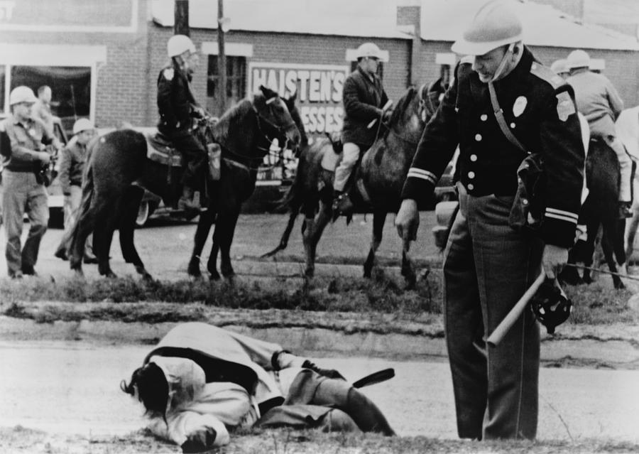 Alabama State Trooper Stands Over An Photograph
