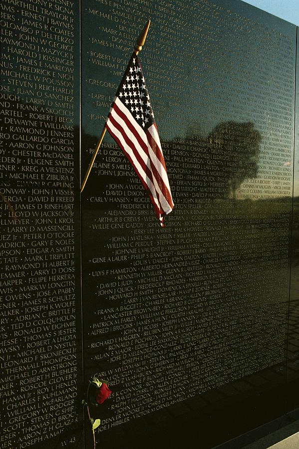 American Flag Left At The Vietnam Photograph