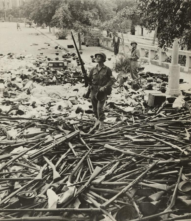 American M.p. Standing On A Large Pile Photograph
