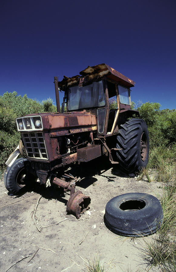 An Abandoned Tractor Rusts Away Photograph