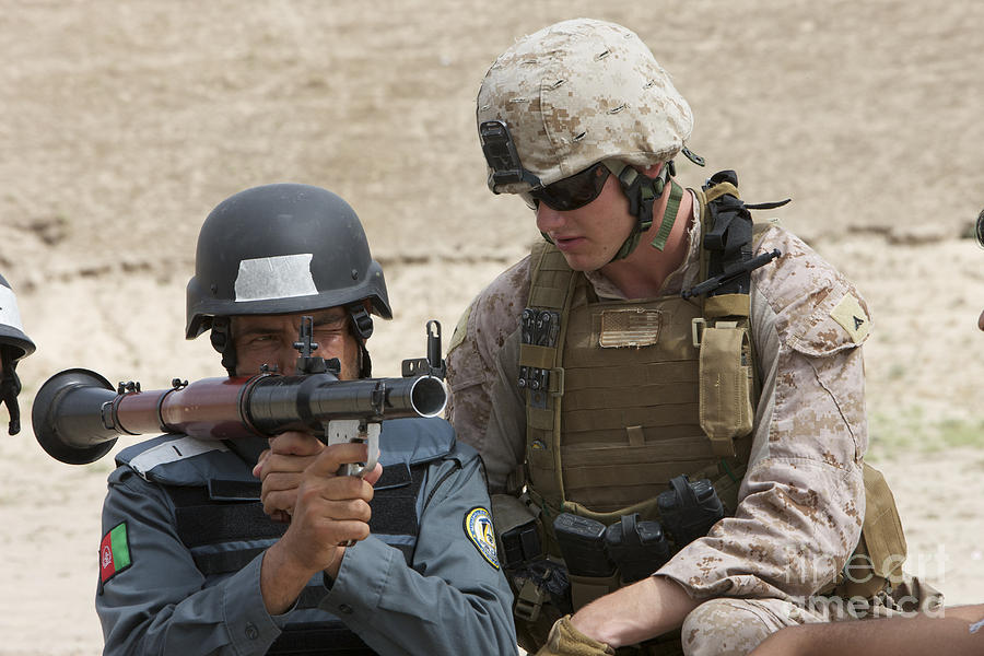 Soldier Photograph - An Afghan Police Student Aiming A Rpg-7 by Terry Moore
