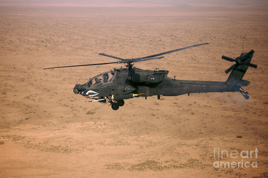 An Ah-64d Apache Longbow Fires A Hydra Photograph