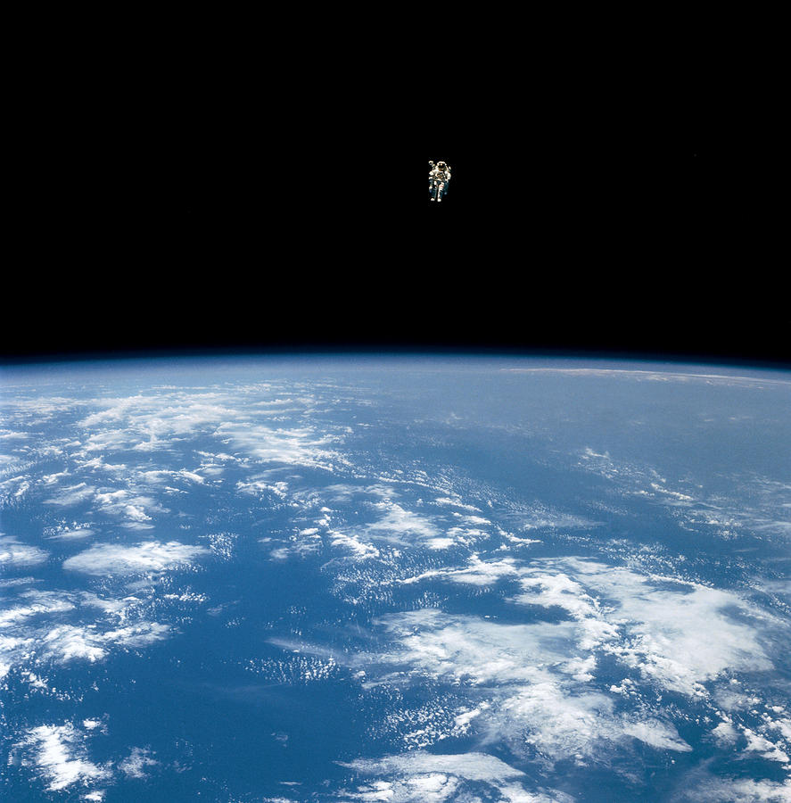 An Astronaut Propelled Above The Earth Photograph
