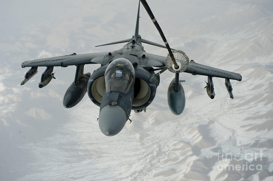 An Av-8b Harrier Receives Fuel Photograph  - An Av-8b Harrier Receives Fuel Fine Art Print