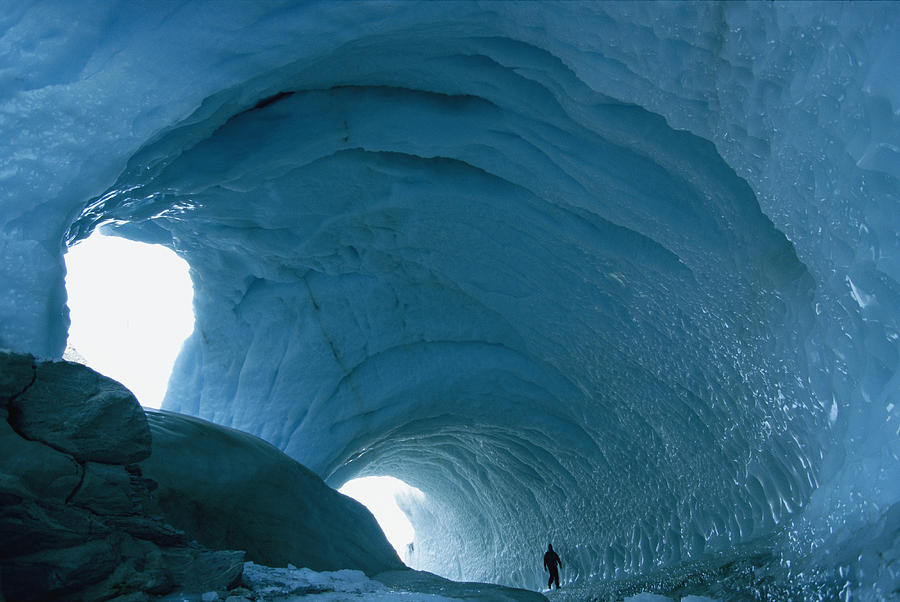 Victoria Land Photograph - An Enormous Icy Tunnel That Looks Like by Maria Stenzel
