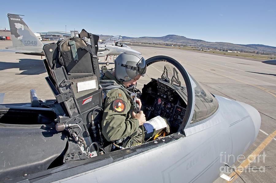 An F-15 Pilot Performs Preflight Checks Photograph