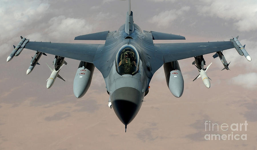 An F-16 Fighting Falcon Flies A Mission Photograph