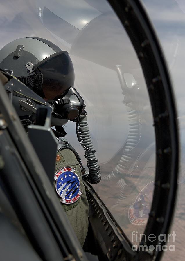 An F-16 Pilot Checks The Position Photograph  - An F-16 Pilot Checks The Position Fine Art Print