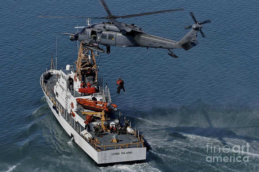 An Hh-60g Pave Hawk Performs A Hoist Photograph