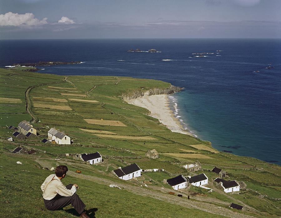 An Irishman Overlooks Cottages That Photograph