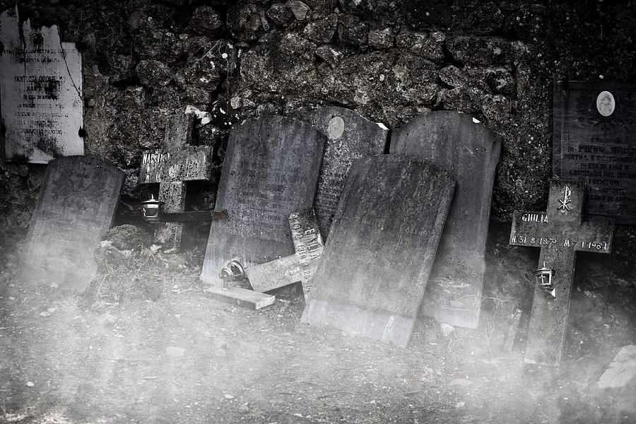 An Old Cemetery With Grave Stones And Fog Photograph