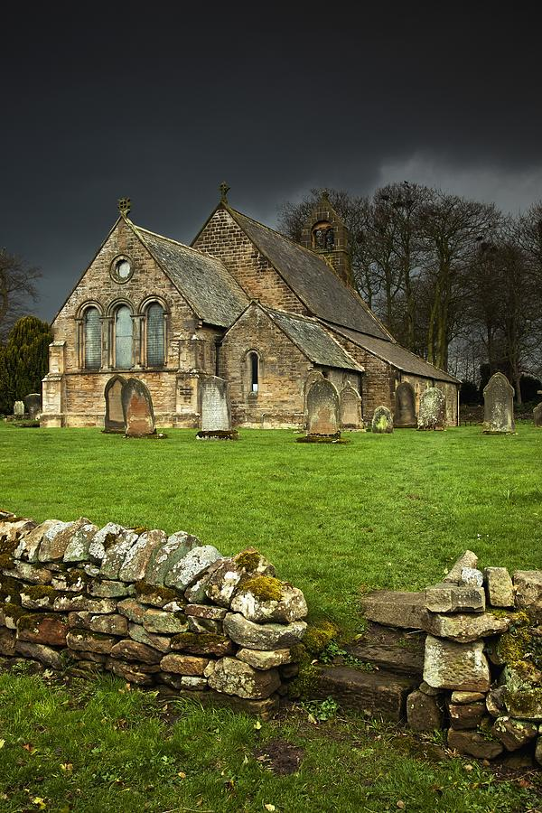 An Old Church Under A Dark Sky Photograph