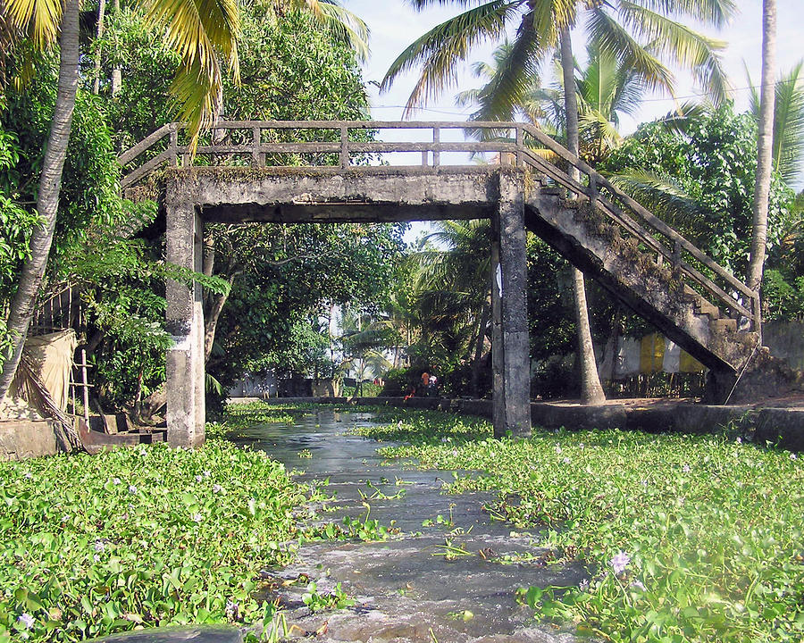 An Old Stone Bridge Over A Canal In Alleppey Photograph