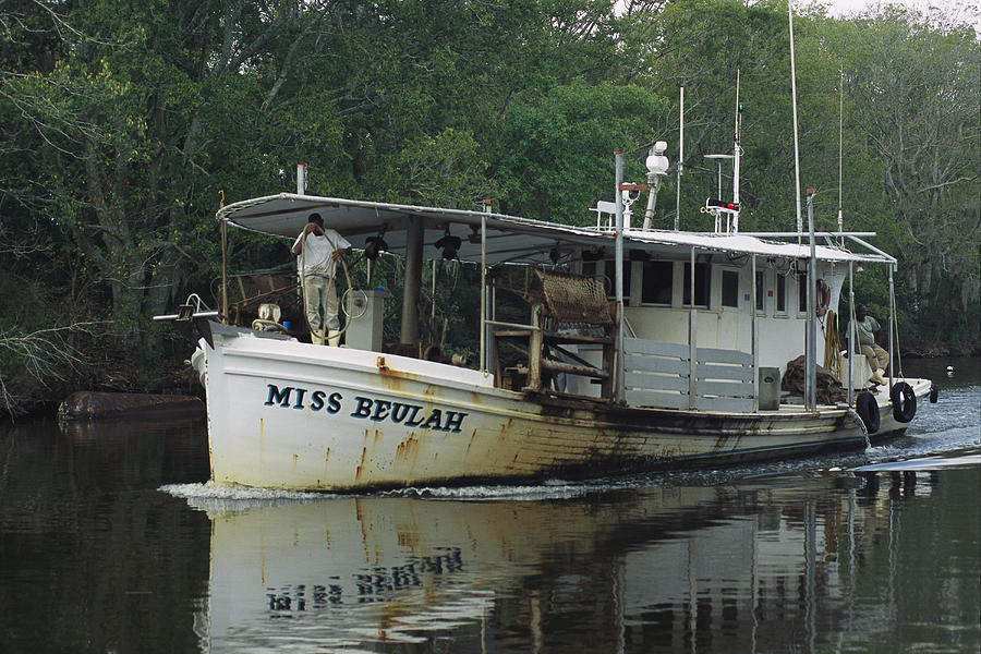 An Oyster Boat Plies The Waters Photograph
