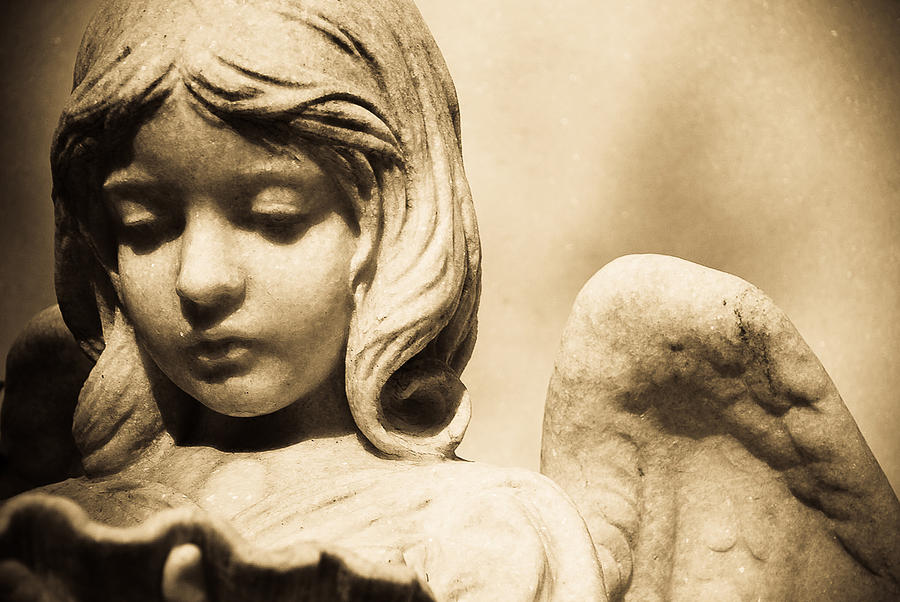 Angel Holding Clam Shell Photograph