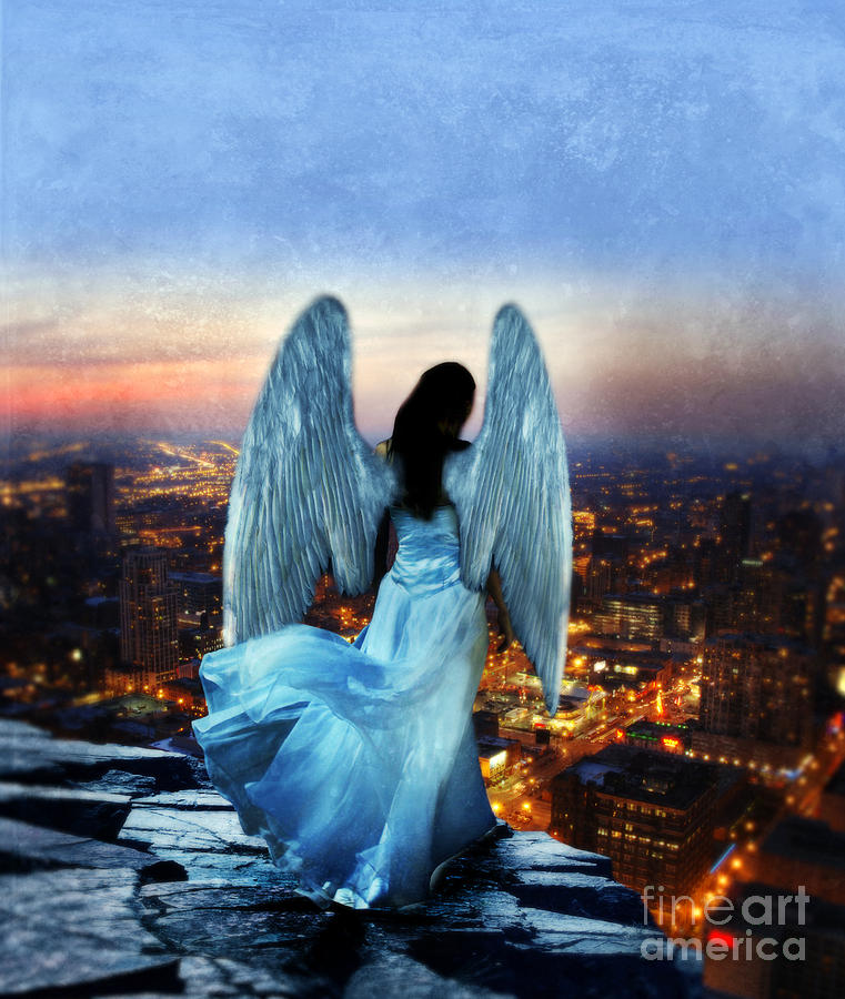 Angel On Rocky Ledge Above City At Night Photograph