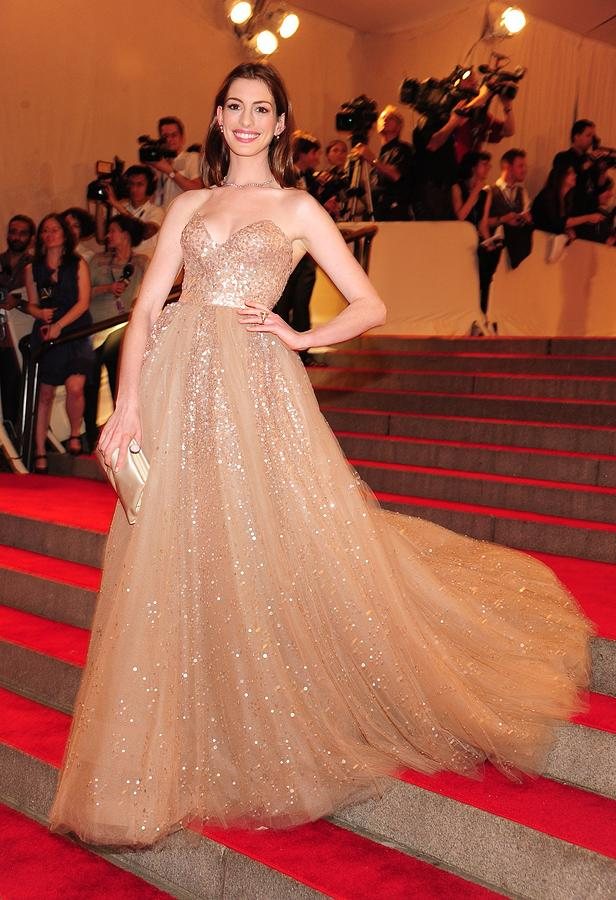 Anne Hathaway Photograph - Anne Hathaway Wearing  A Valentino Gown by Everett