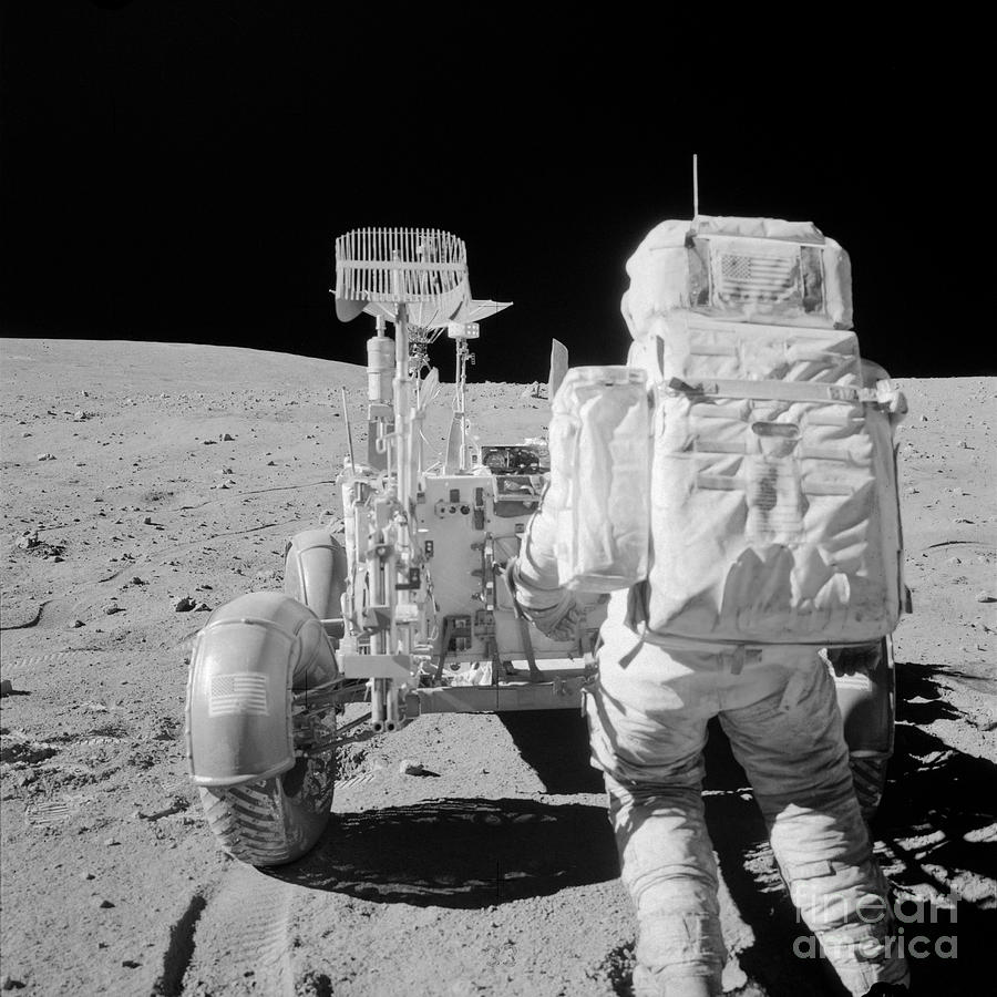 Apollo 16 Astronaut Reaches For Tools by Stocktrek Images