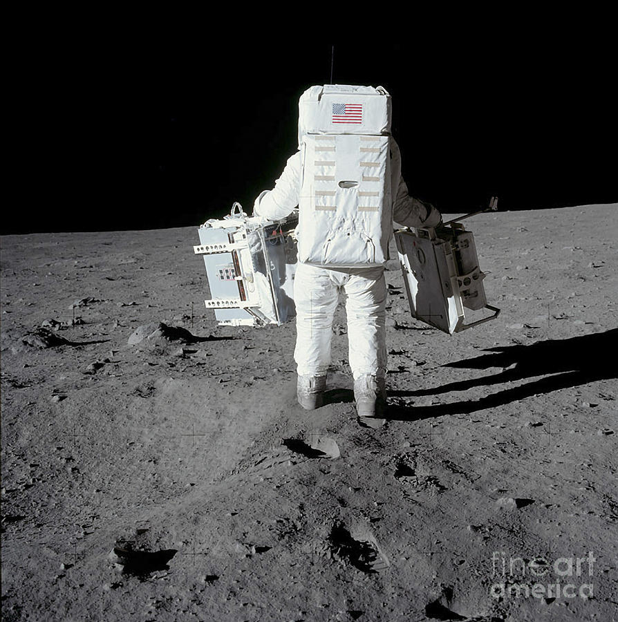 Astronaut Carrying Equipment Photograph