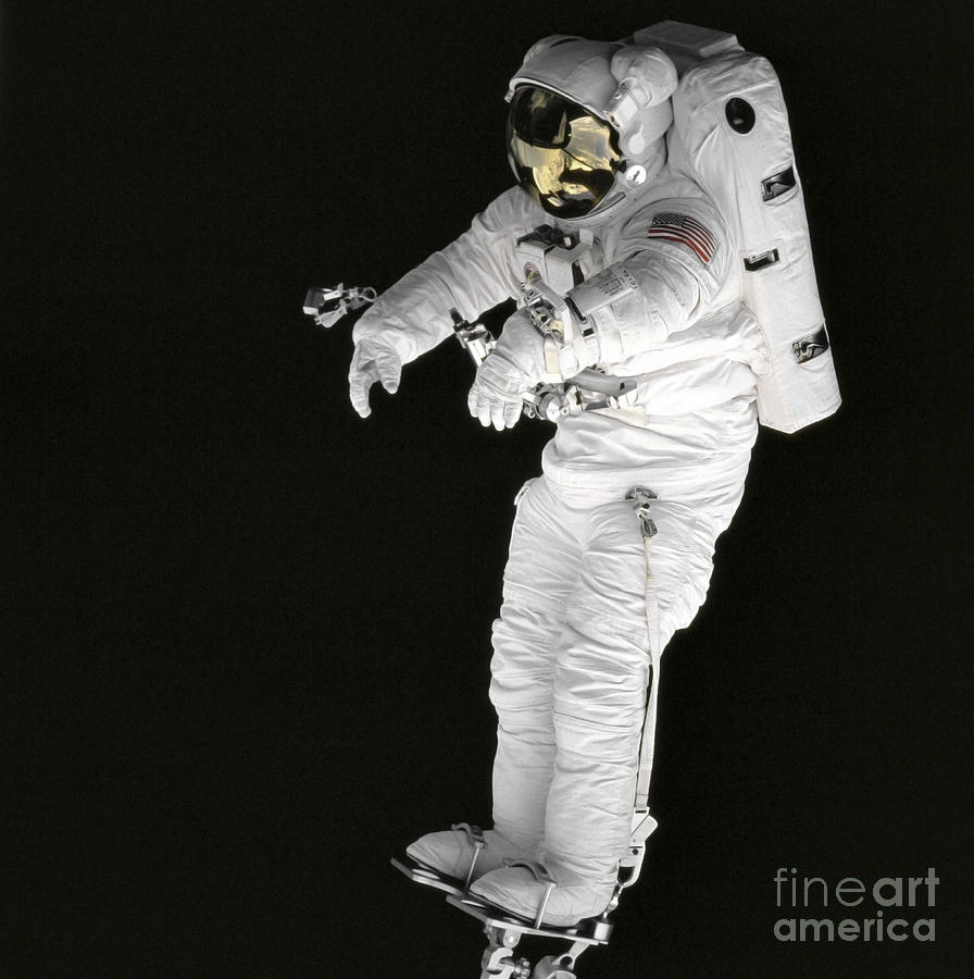 Square Image Photograph - Astronaut Stands On A Portable Foot by Stocktrek Images