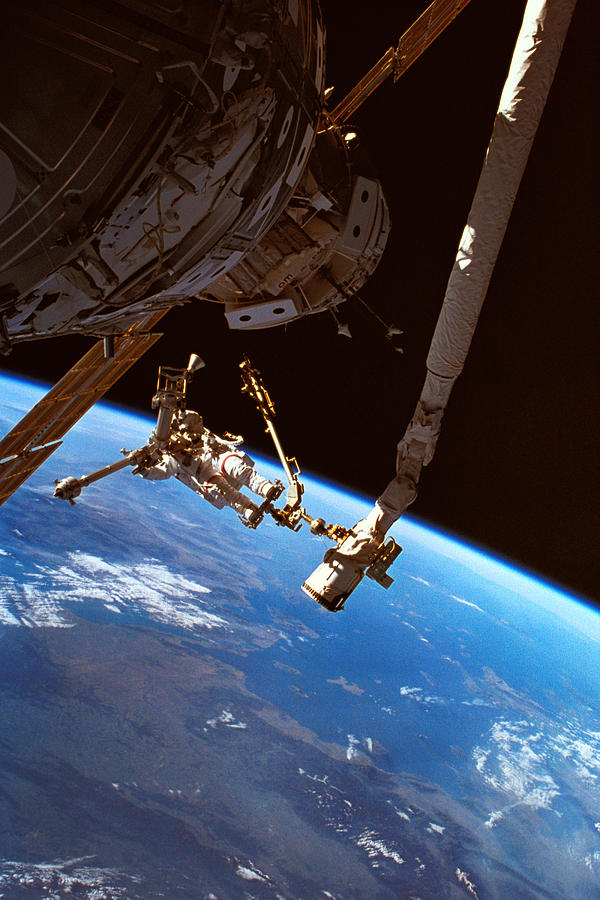 Astronauts Working On A Satellite In Space Photograph  - Astronauts Working On A Satellite In Space Fine Art Print