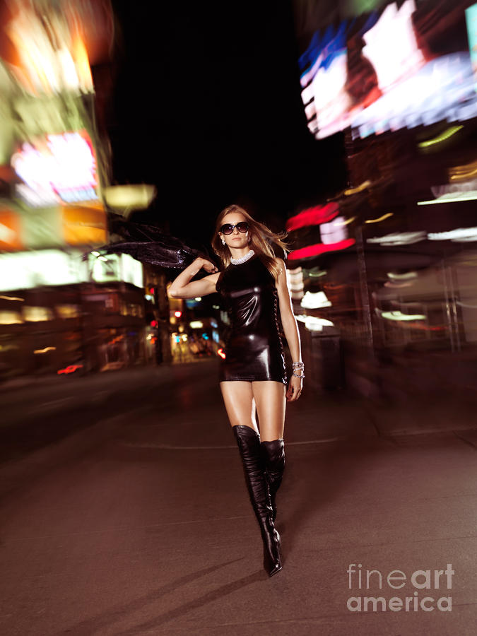 Attractive Young Woman Walking Down The Street At Night Photograph