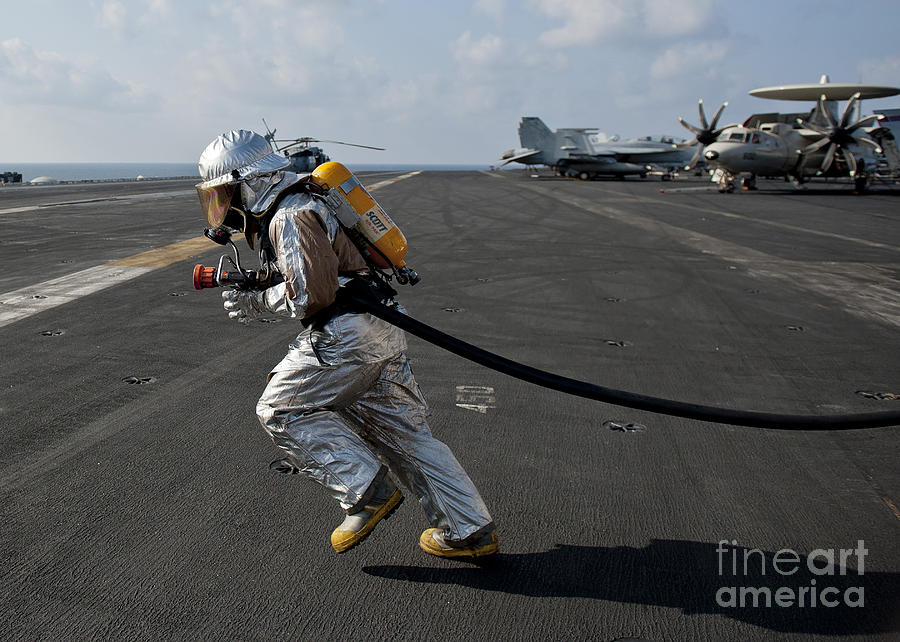Aviation Boatswain's Mate Carries Photograph  - Aviation Boatswain's Mate Carries Fine Art Print