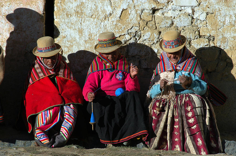 Aymara Women Spinning Wool. In The Bolivian Altiplano. by Eric Bauer