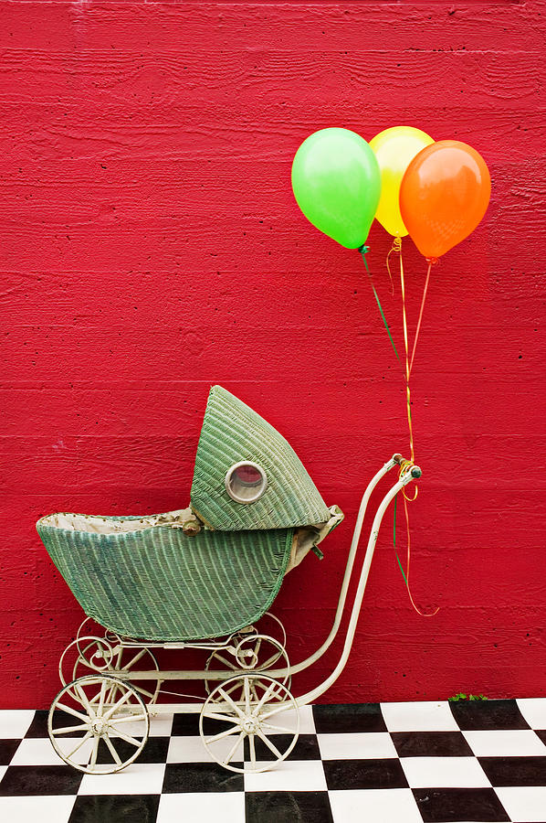 Baby Buggy With Red Wall Photograph