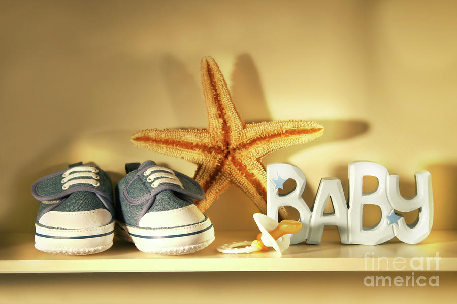 Baby Shoes On The Shelf Photograph