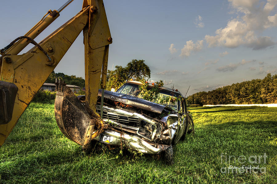Backhoe Pulling Car Out Of Field Photograph